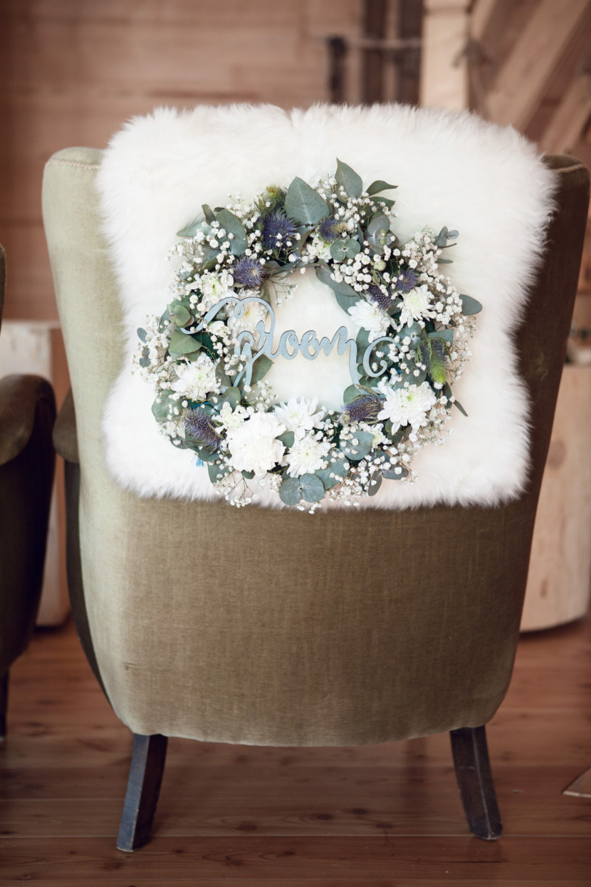 Wedding decoration with live flowers wreath with the inscription groom